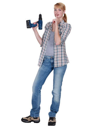 shush: Woman with power drill making shush gesture