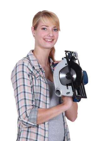 Mujer con una sierra circular Foto de archivo - 13878919