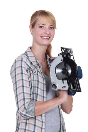 Woman with a circular saw photo