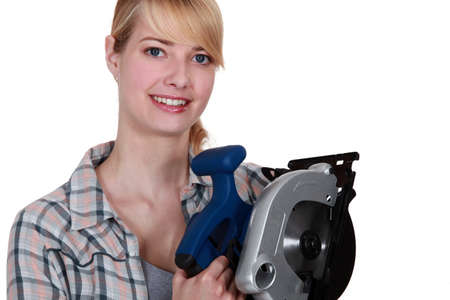Woman holding circular saw photo