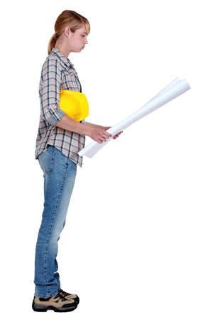 Female builder with plans photo