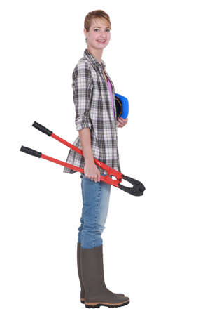 Woman carrying bolt cutters photo
