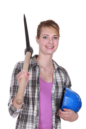 young female bricklayer posing with pickaxe and hard hat Stock Photo - 13882047