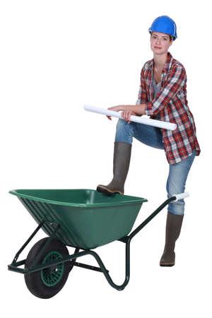 Female builder with wheelbarrow photo