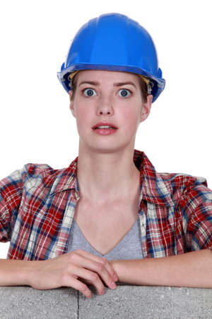 Alarmed female construction worker photo