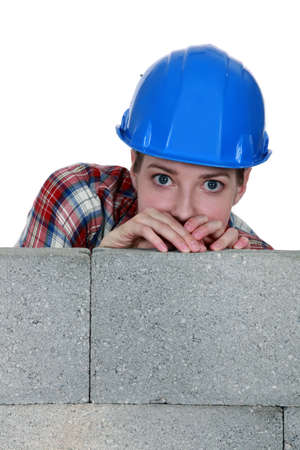 A terrified tradeswoman Stock Photo - 13912416