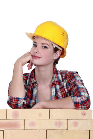 Thoughtful female construction worker photo
