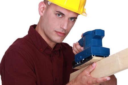 Man using electric sander photo