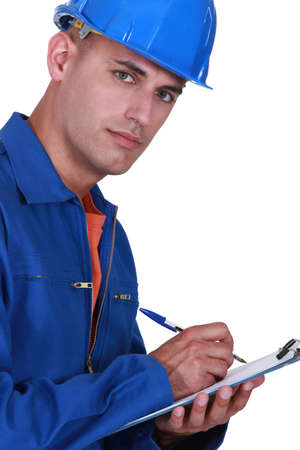 Inspector writing on clip-board Stock Photo - 13884818