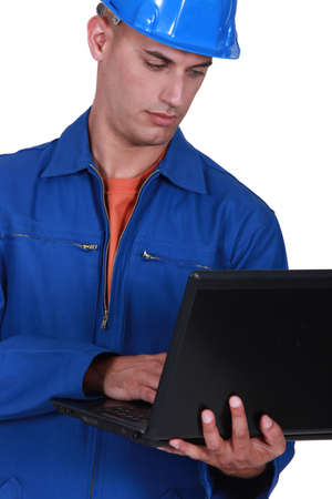 Plumber with a laptop photo