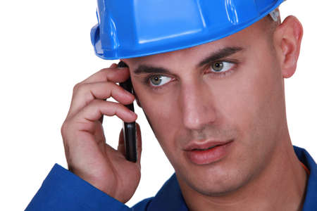 Man with a hardhat and cellphone photo