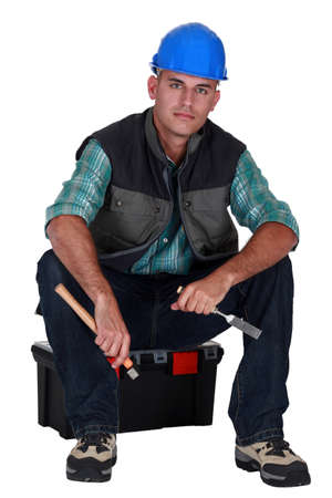 Handyman sat on his tool box photo