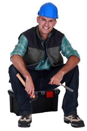 englishman: Working sat on tool box Stock Photo