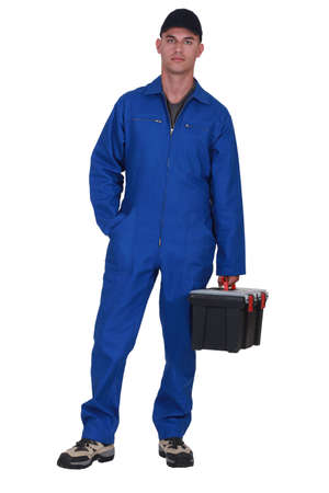 Man arriving at work with tool box photo