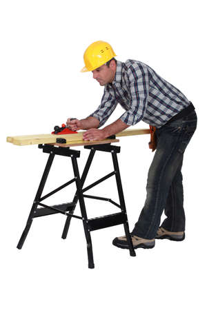 supported: Carpenter sanding Stock Photo