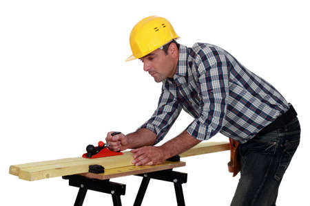Builder planning wood Stock Photo - 13852587