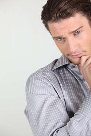 Skeptical young man photo