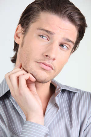 scratching head: handsome guy puzzled Stock Photo