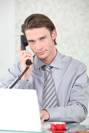 capitalist: young businessman making a call