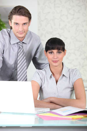 secretary desk: Smart young business people