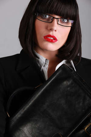 Woman with glasses and black bag photo