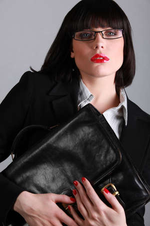 Stunning businesswoman with a black leather briefcase photo