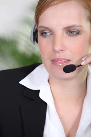 Receptionist with headphones and microphone Stock Photo - 13899381
