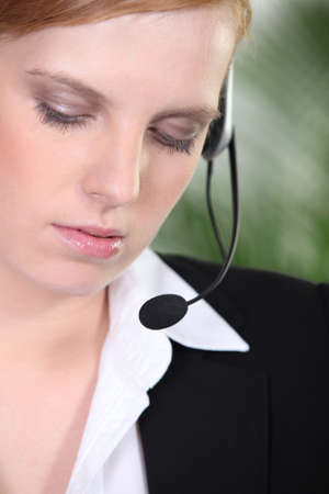Woman in suit with headset photo