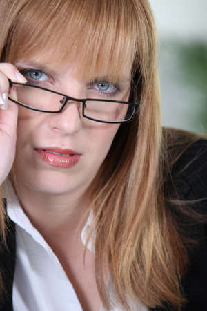 Blonde woman with glasses photo