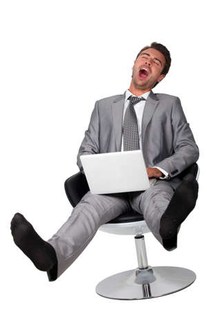 business with computer yawning photo