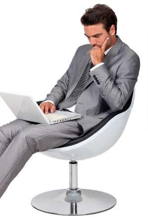 Smart businessman using laptop photo