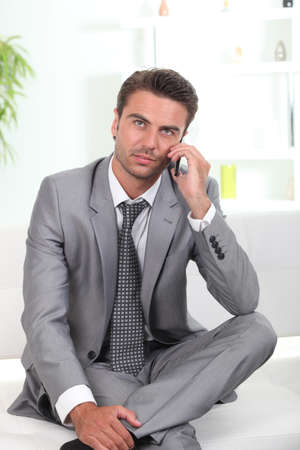 Business man with mobile Stock Photo - 13901741