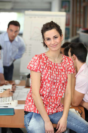 Woman sitting in a workplace presentation photo