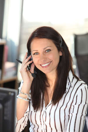 Smiling woman with a telephone headset photo