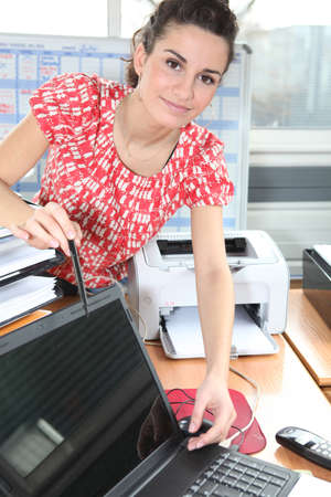 manipulating: Women manipulating computer in the office Stock Photo