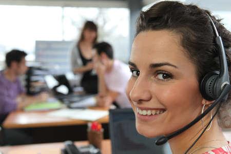 Woman wearing a telephone headset photo