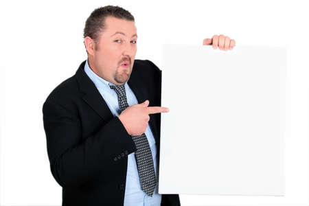 Businessman showing panel for message photo