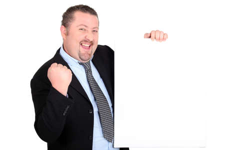 euphoric: A successful businessman holding up a blank sign