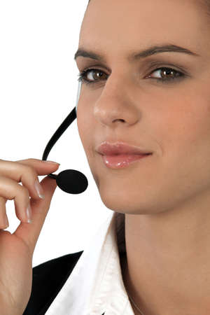Close-up of a woman using a telephone headset photo