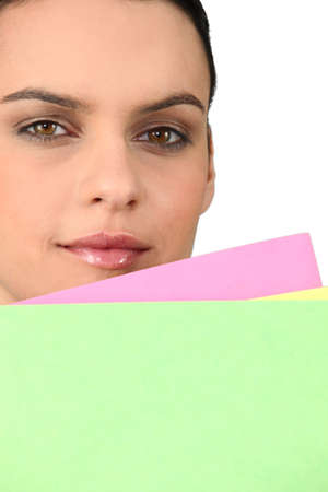 pale colours: Secretary holding up colourful file folders