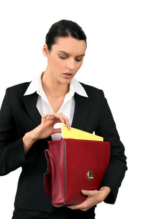 Businesswoman with leather briefcase photo