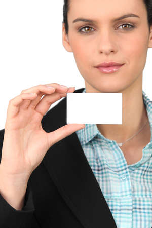 Smart woman holding a blank business card Stock Photo - 13881286