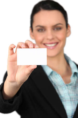 all smiles: woman all smiles holding business card Stock Photo