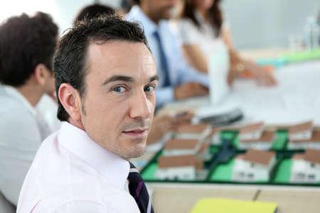 Architect sitting at a desk photo