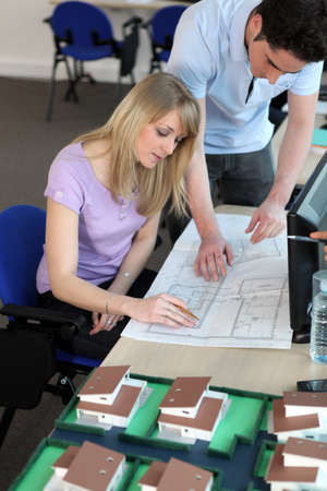 Two architects working on blueprints Stock Photo - 13903872