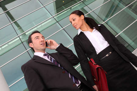 conference call: Collaborators leaving work Stock Photo