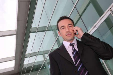 un hombre de negocios en el tel�fono Foto de archivo - 13883673