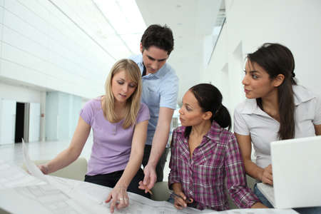 Architects consulting a blueprint Stock Photo - 13901738