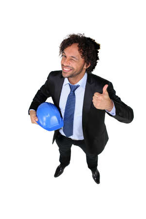 Businessman with a hardhat and the thumbs up photo