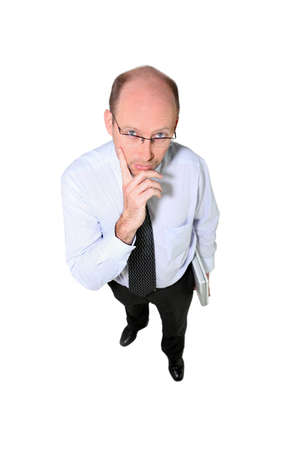 High-angle shot of a businessman deep in thought photo